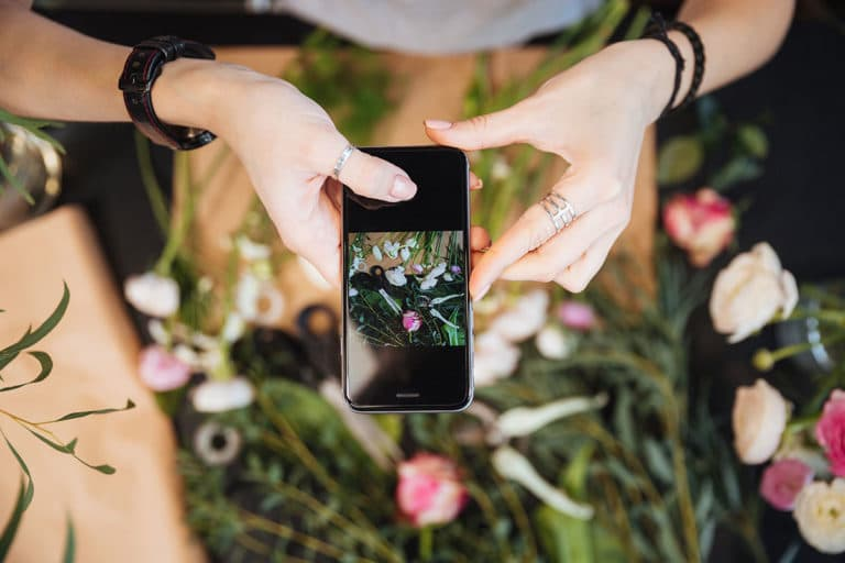 taking photo of flowers